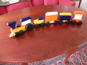 Wooden train in bright colors. For a toddler